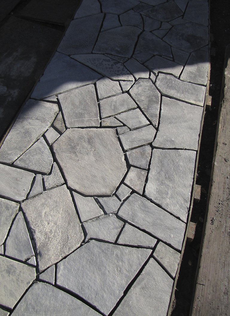 """Halswell stone """"crazy paving"""" path laid on a concrete base"""