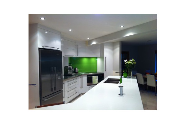 Contemporary White Kitchen with White Corian and Stainless Steel Bench Tops