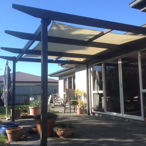 Backyard decking and porch work by Constructive Landscape Solutions