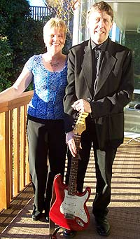 Peter and Claire, members of the duo band.