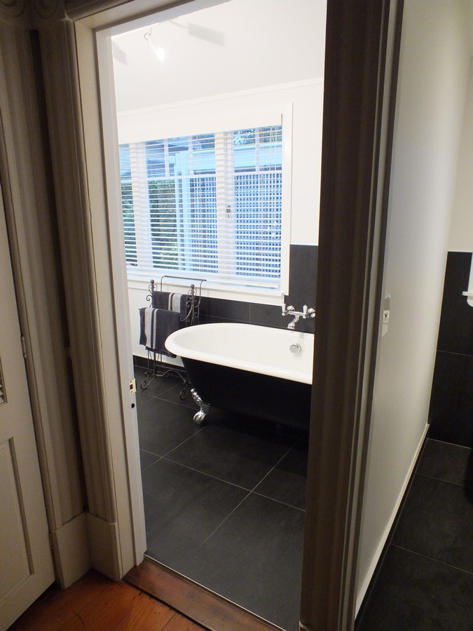 Bathroom Renovation, Classic black and white, tiled floor, Clawfoot bath