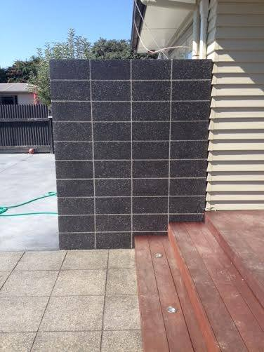 Black block wall water feature by Constructive Landscape Solutions