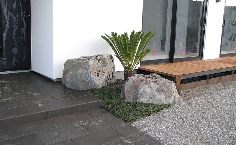 Bluestone path and entrance landing, accompanied by a simple, yet modern and effective planting with feature rocks