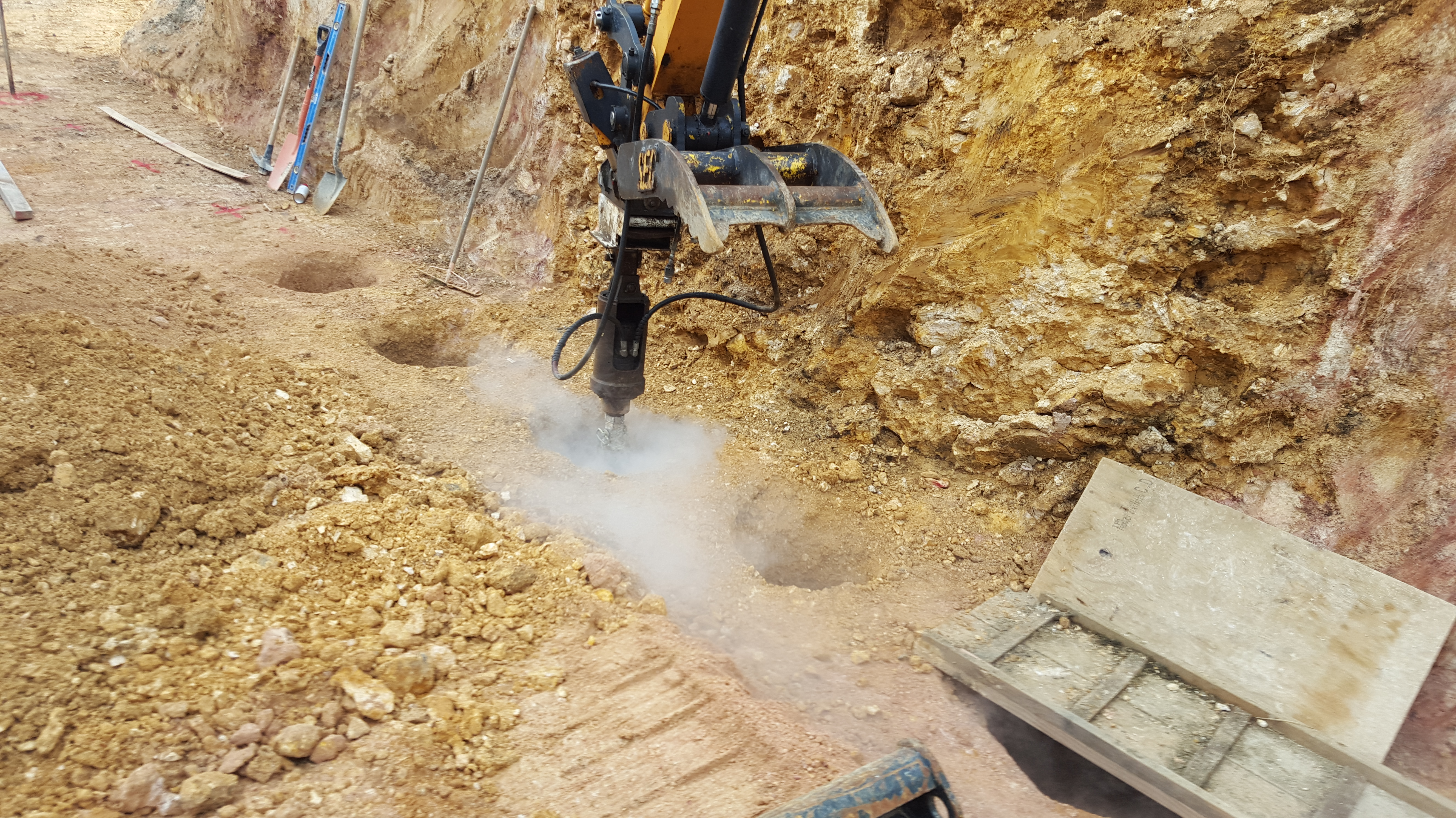 drilling through rock for retaing walls
