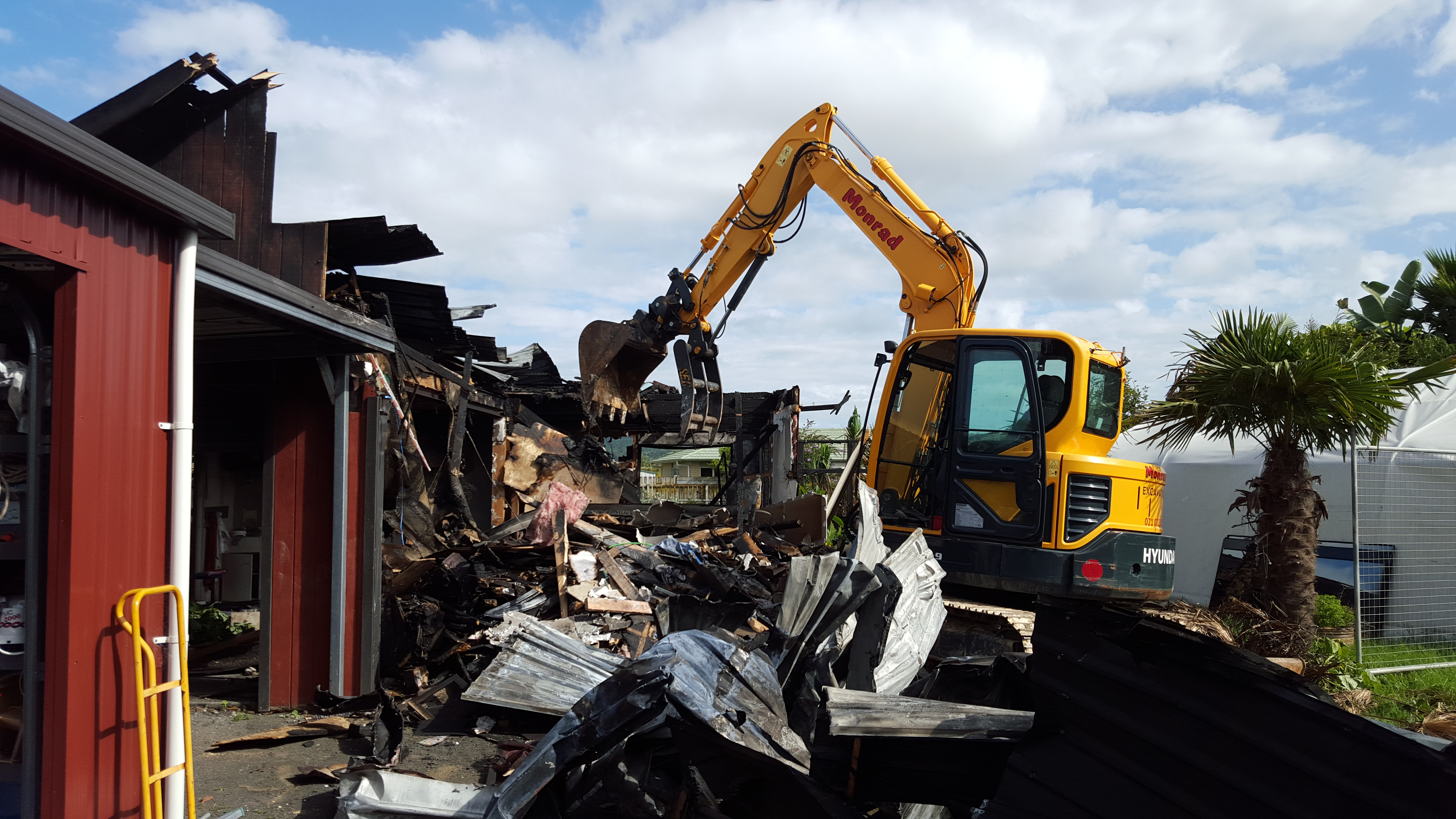 demolishing a burnt out home