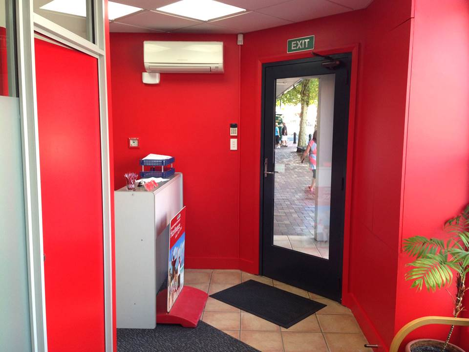 After - Complete interior repaint of Fico Finance office in Nelson with 'Hot Lips' red - March 2014