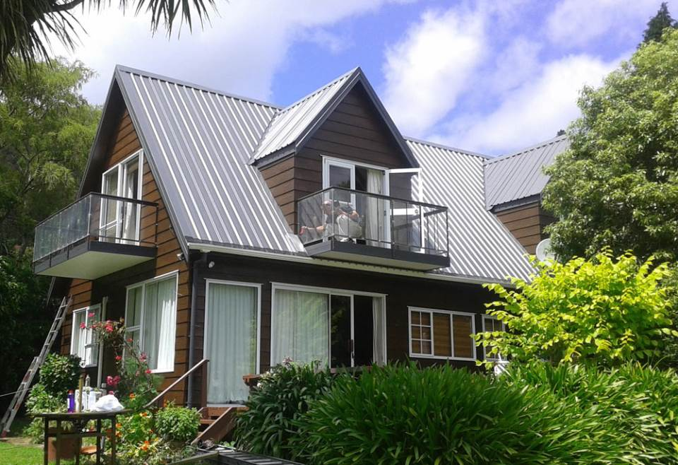 Marlborough Sounds bach - exterior repaint of roof and weatherboards - completed 2013