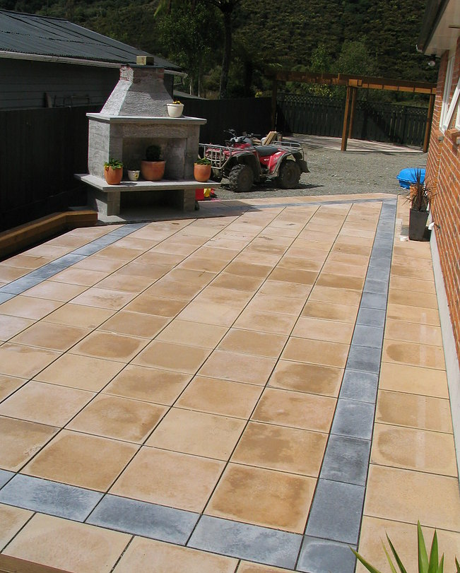 Outdoor entertaining patio area, with outdoor fire and laid pavers. Garden and lawn later linked to rear pergola
