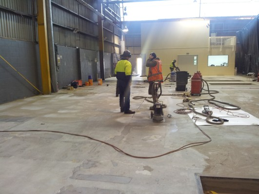 Preparing a non-slip floor by Andy Andersons Industrial Services 2007 Ltd in Auckland